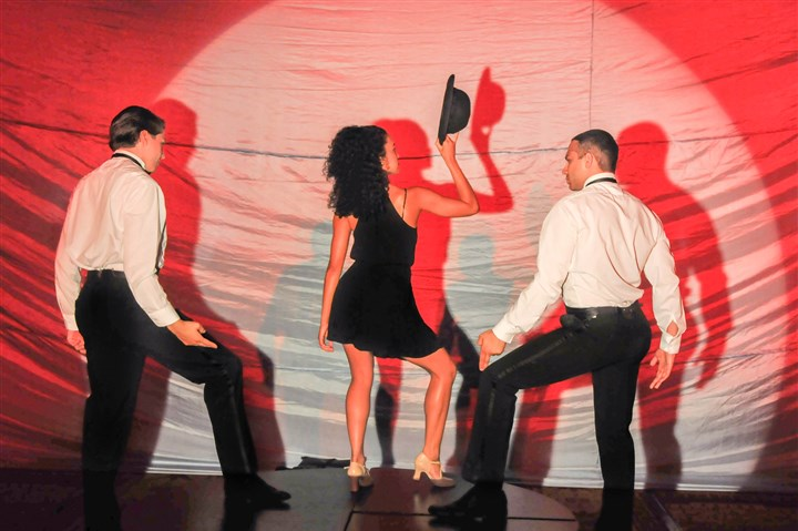 From left, Jared Roberts, Dayne Board and Jeff Gordi perform during the CLO Gala