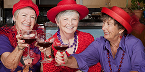 Three Ladies in red hats