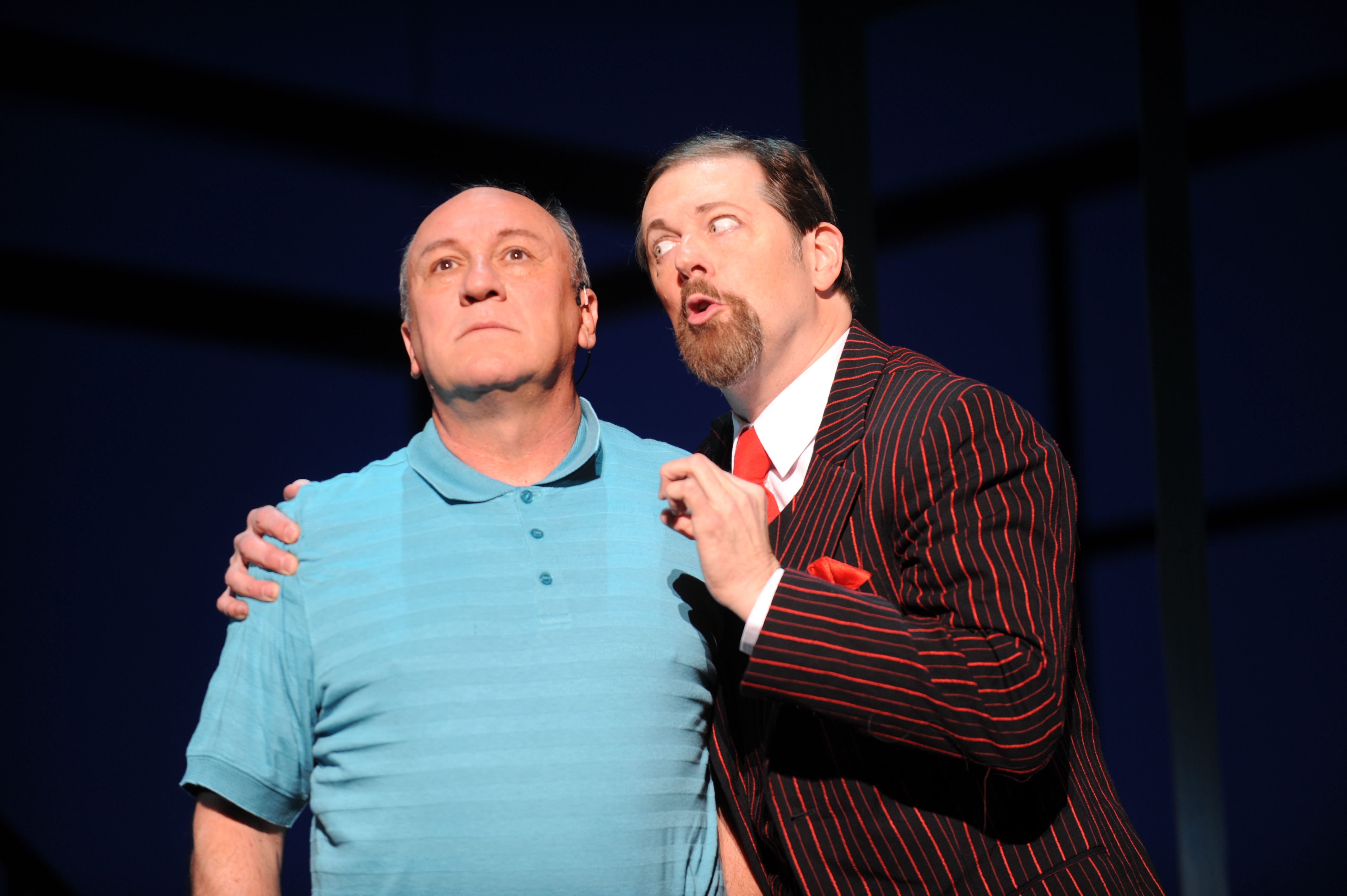 Jeffrey Howell as Joe Boyd and John Bolton as Applegate in 'Damn Yankees' playing through July 10 at the Benedum Center.