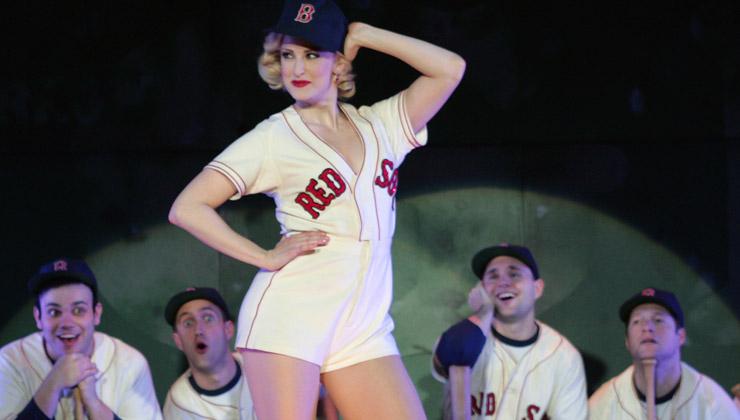 Lola posing in a baseball uniform